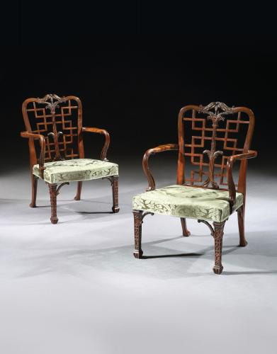 A Pair of George III Mahogany Chinoiserie Armchairs in the manner of Thomas Chippendale