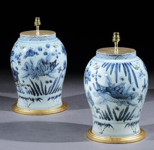 A Pair of Chinese Blue and White Vases with Fish and Foliage Now Mounted as Lamps
