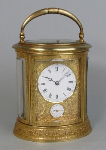 Drocourt An engraved oval carriage clock