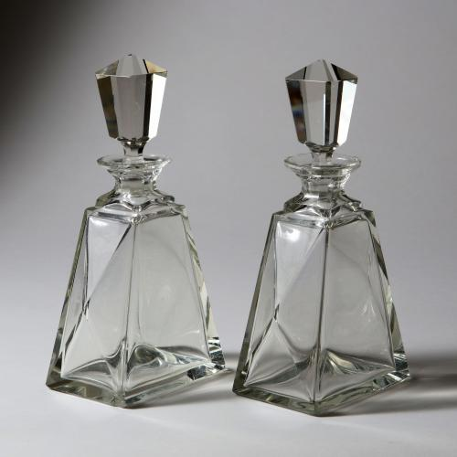 A pair of cut glass Art Deco spirit decanters