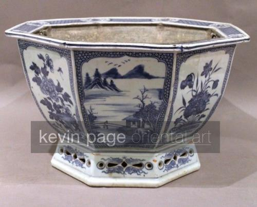 A chinese blue and white chien lung jardinière with a metal lining