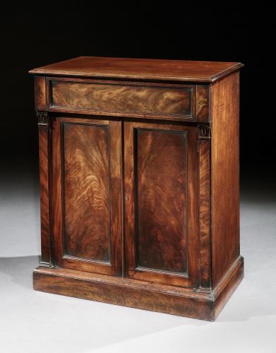 An early 19th century mahogany cabinet