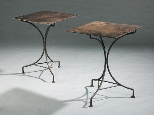 A pair of cast iron tables