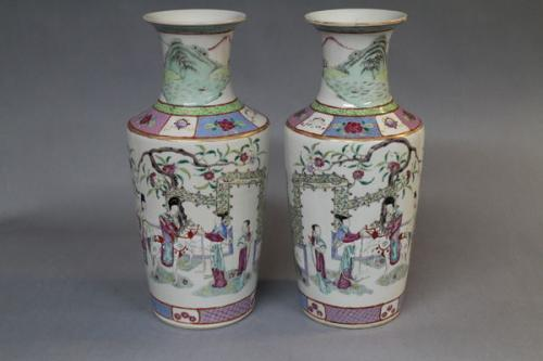 A pair of small 19th century chinese famille rose vases