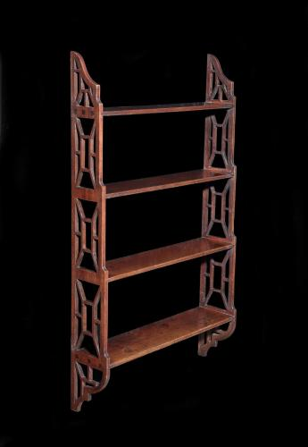 A George III mahogany hanging book shelf