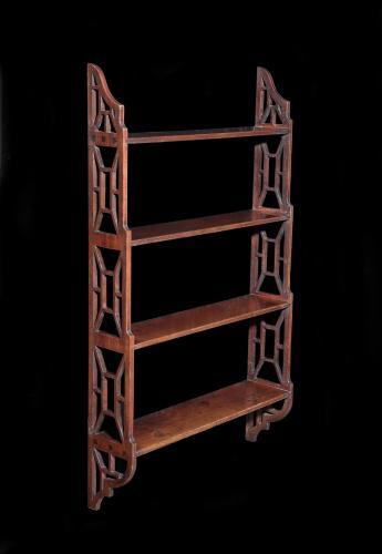 A George III mahogany hanging book shelf