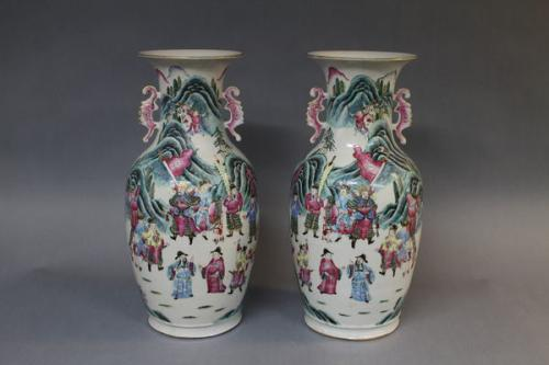 A pair of 19th century chinese famille rose vases with twin handles