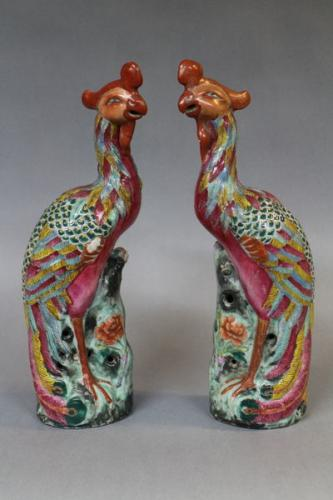 A pair of 19th century chinese famille verte enamelled figures of phoenix