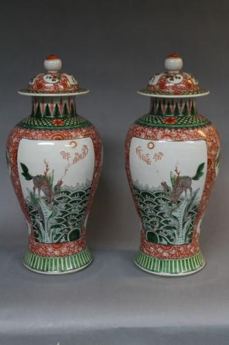 A pair of 19th century chinese famille verte vases and covers