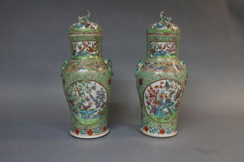 A pair of 19th century chinese famille verte porcelain jars and covers