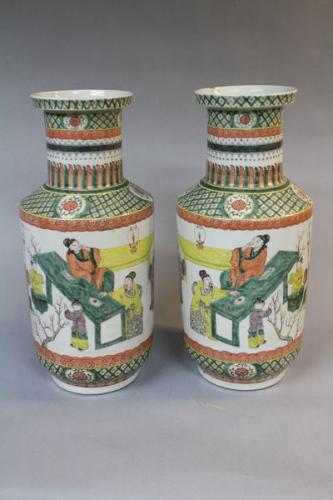 A mirrored pair of 19th century chinese famille verte vases