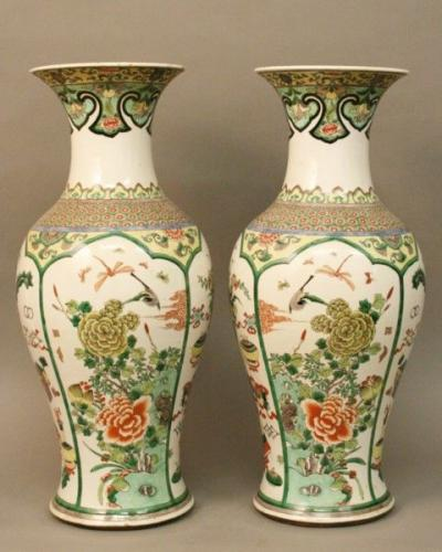 A pair of famile verte vases with panels of pictures of flower in vases