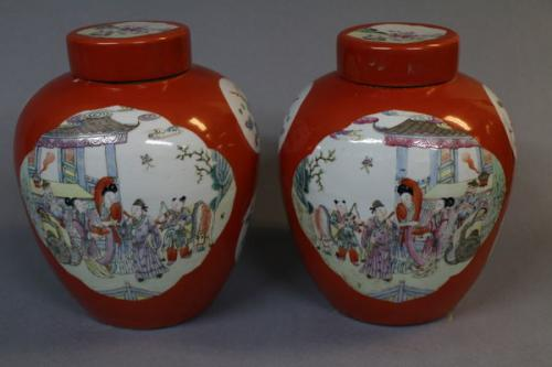 A pair of 19th century chinese orange round ginger jars