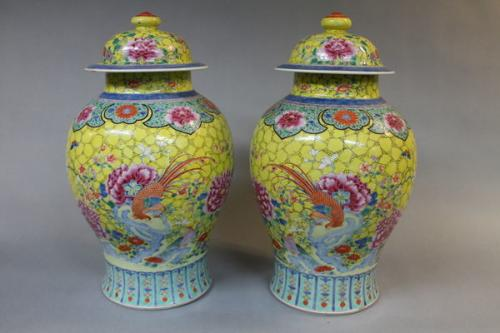 A pair of 19th century chinese yellow ground vases