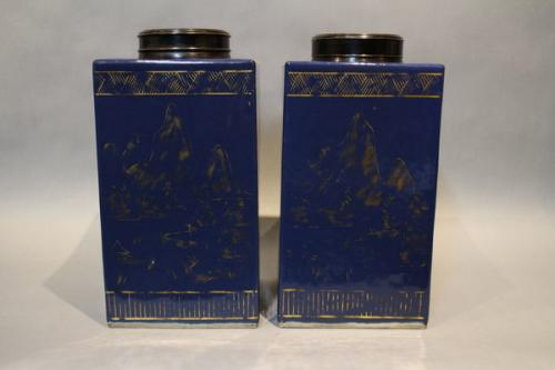 A pair of 18th century chinese powder blue glazed tea canisters