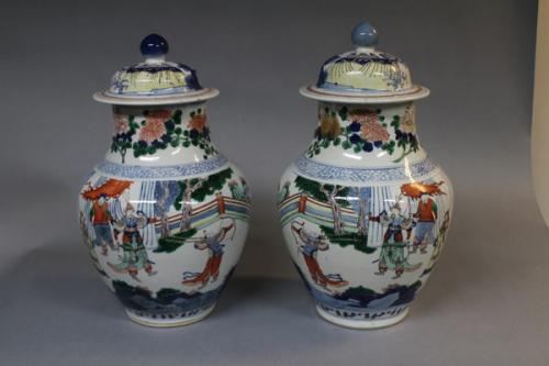 A pair of 19th century chinese wocai jars and covers