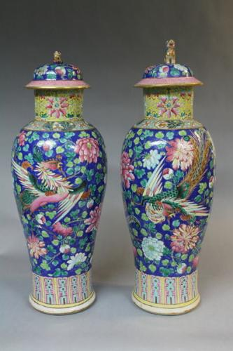 A pair of 19th century chinese polychrome vases and covers