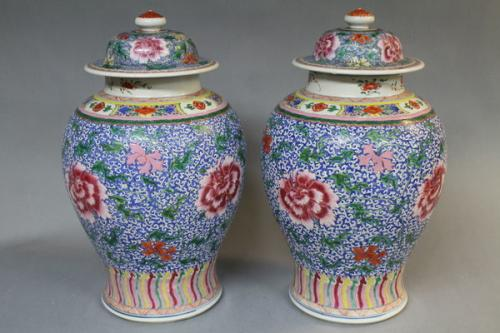 A pair of yung-cheng chinese polychrome jars and covers