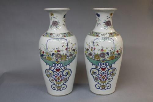 A pair of 19th century chinese polychrome vases
