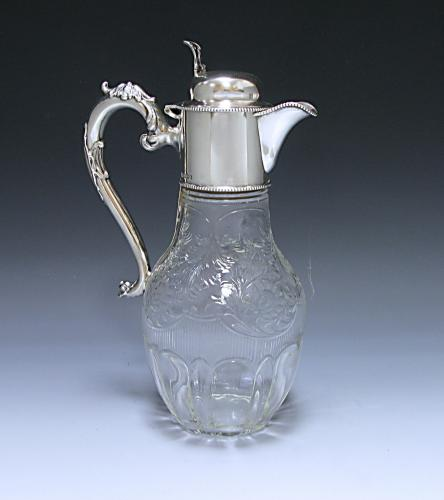 An Antique Silver and Glass Claret Jug