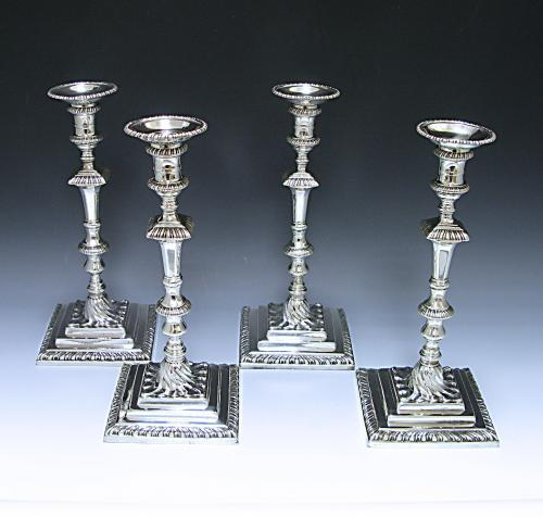 A Set of Four George III Cast Sterling Silver Candlesticks