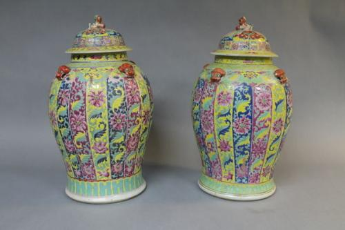 A large pair of 19th century chinese polychrome enamelled porcelain jars and covers