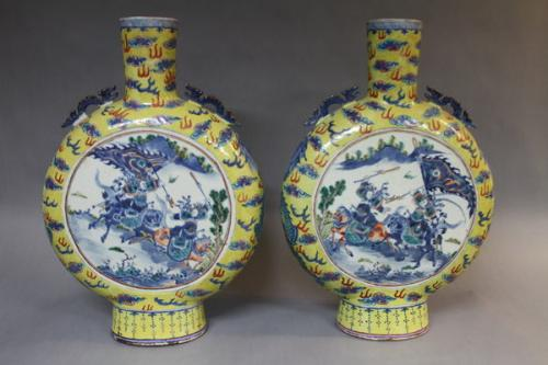 A pair of 19th century chinese yellow ground moon flasks
