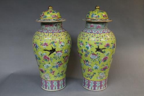 A pair of 19th century chinese famille juane jars and covers