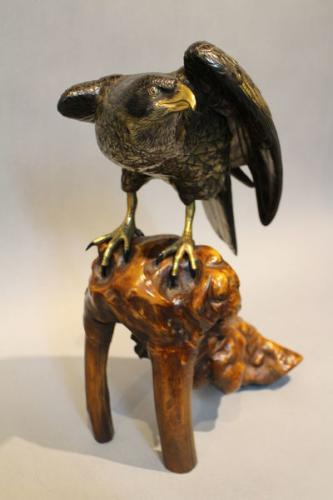 a 19th century japanese multipattenated bronze hawk on wood stand