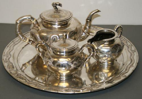 A silver tea set decorated with dragons