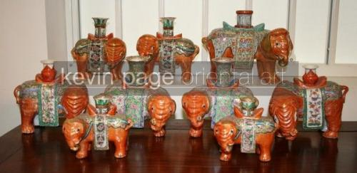 a collection of candlestick holders in the form of elephants