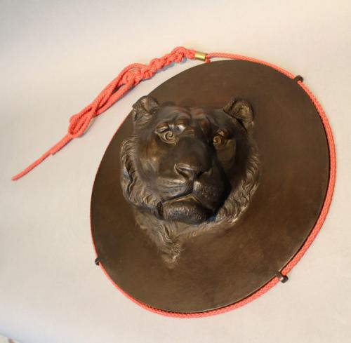 A 19th century japanese bronze tiger's head plaque