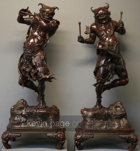 A pair of large japanese bronzes of raijin and fujin