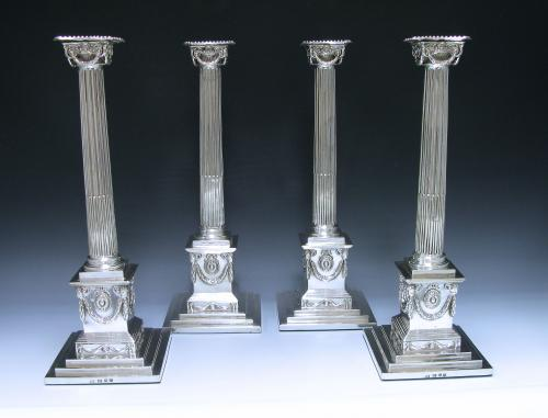 A Set of Four George III Sterling Silver Candlesticks