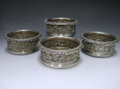 A Set of Four George IV Silver Wine Coasters