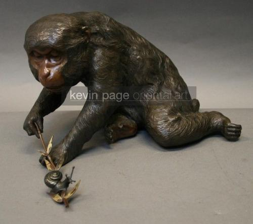 A charming bronze of a monkey and a snail