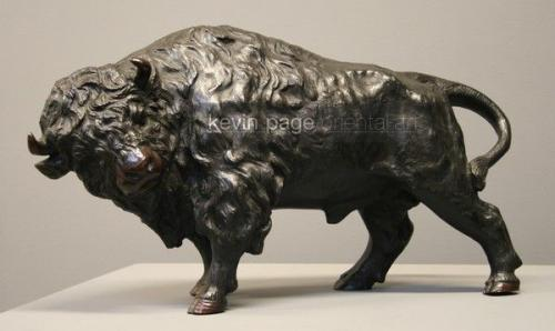 A japanese bronze sculpture of a buffalo