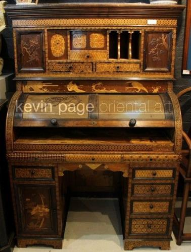 An elaborate japanese marquetry bureau writing desk