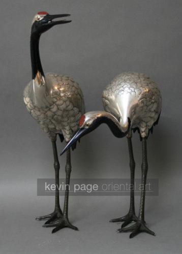 A pair of silvered bronze cranes