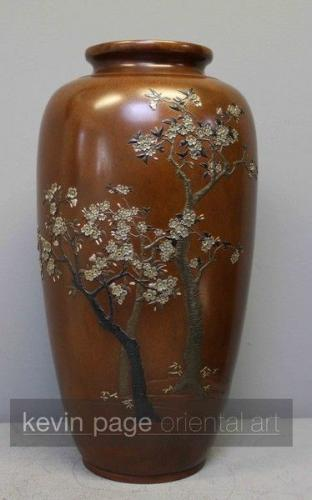 An elegant japanese vase decorated with multimetal cherry blossom