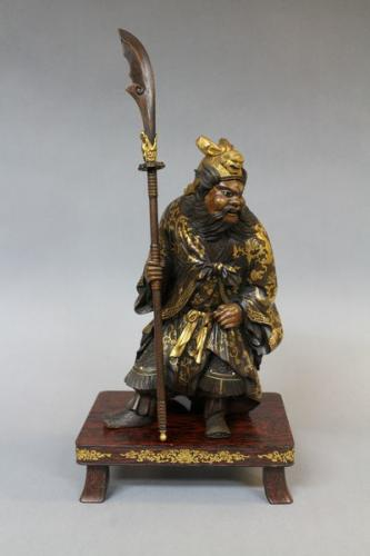 A japanese meiji period carved wood figure of quan yu
