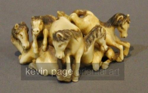 a signed miniature japanese okimono of a pile of horses
