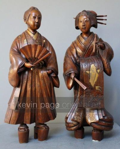 A large pair of carved wood japanese figures