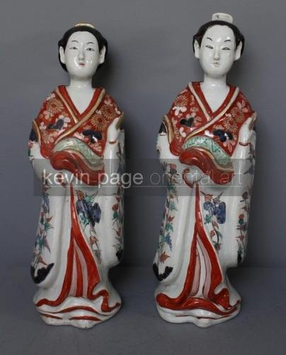 A pair of antique japanese arita geisha figures with thistle pattern robes