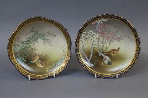 a pair of japanese kinkozan satsuma plates with blue and gilt lobbed rims