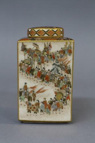 A japanese kozan satsuma tea storage jar decorated with processions