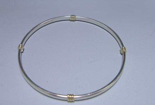 A Sterling Silver and 9ct Gold Bangle