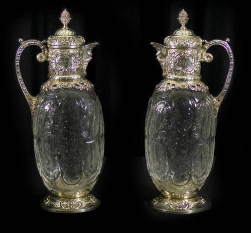 Pair Antique Silver and Carved Glass Claret Jugs