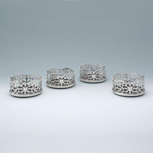 A Set of Four George III Antique English Silver Wine Coasters