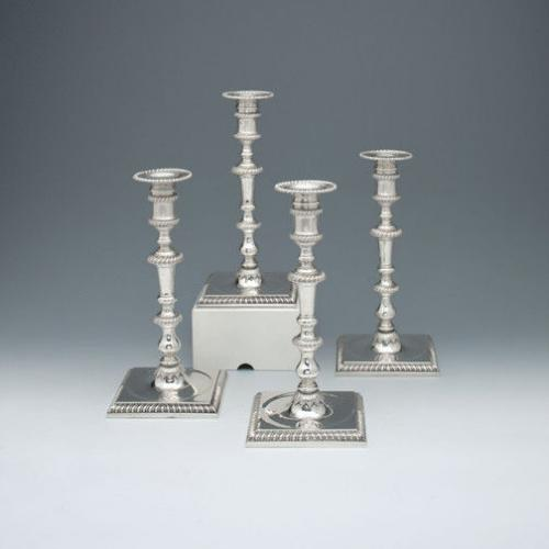 A Set of Four George II Antique English Silver Candlesticks